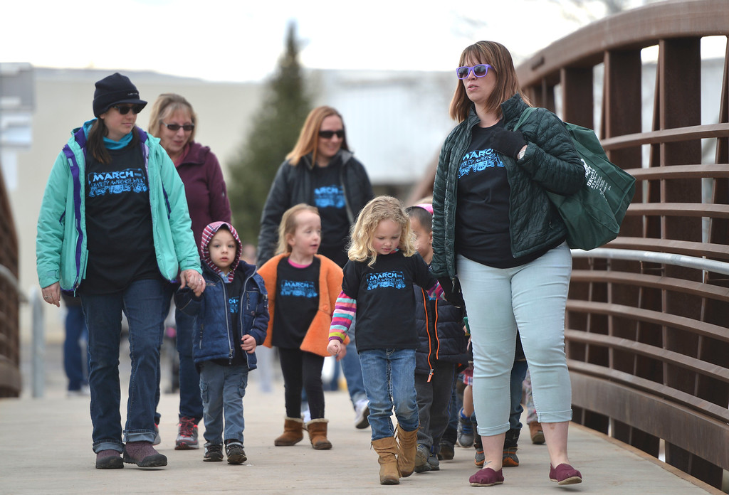 Justin Sheely | The Sheridan Press<br /> Children from the Child Development Center preschool participate in the annual Disabilities Awareness March at South Park Friday March 23, 2018. In front, from left, Kristina Miller with preschoolers Maxwell Frabell and Chloe Chase walked by Ashly Garretson. March was established as national Developmental Disabilities Awareness Month by President Ronald Reagan in 1987. [note, Ashly is spelled correct]
