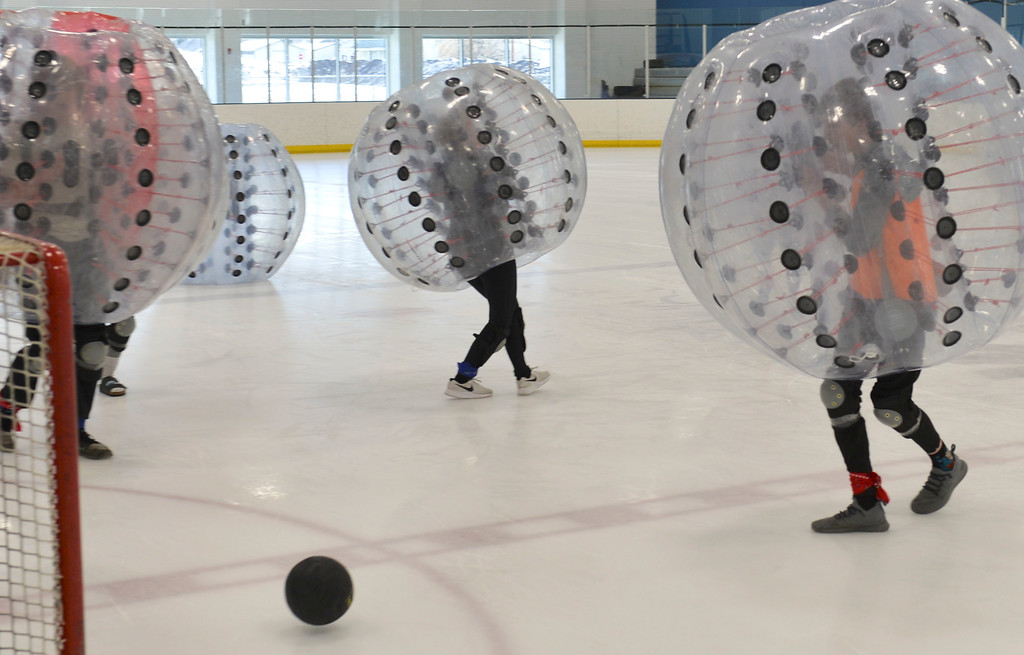 Justin Sheely | The Sheridan Press<br /> Connor Goss, right, scores for his team during KidsLife Bubble Ball Hockey at Whitney Ice at the M&M's Center Saturday, March 24, 2018.