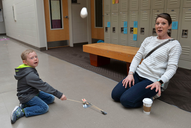 Justin Sheely | The Sheridan Press<br /> Five-year-old Nolan Smith, left, and Meredith Smith react as they launch a marshmallow from a catapult during Science Saturday at the Sheridan College Science Center Saturday, March 24, 2018. The catapults were made from mouse traps, dowls and duct tape.