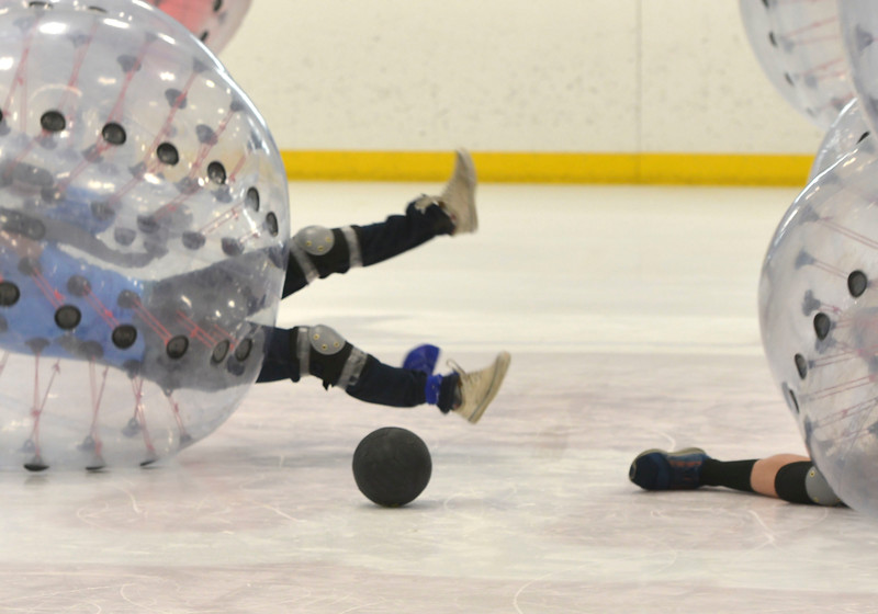 Justin Sheely | The Sheridan Press<br /> The ball eludes players during KidsLife Bubble Ball Hockey at Whitney Ice at the M&M's Center Saturday, March 24, 2018.