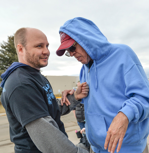 Justin Sheely | The Sheridan Press<br /> RENEW individual support advocate Josef Kerr, left, visits with Kimbro Kent during the annual Disabilities Awareness March at South Park Friday March 23, 2018. March was established as national Developmental Disabilities Awareness Month by President Ronald Reagan in 1987.