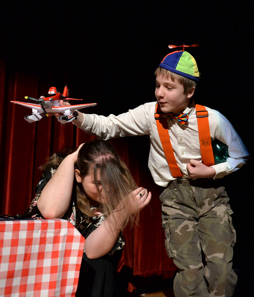 "Justin Sheely | The Sheridan Press<br /> Emily Kidneigh, left, ducks as Brodie Juergens flies a toy airplane overhead during a rehearsal for ""Check, Please"" at Big Horn High School Saturday, March 24, 2018. The BHHS drama department is presenting the one-act comedy March 27 and 28 at 7 p.m. at the Big Horn High School auditorium. Admission is free, donations are encouraged to benefit the drama department."
