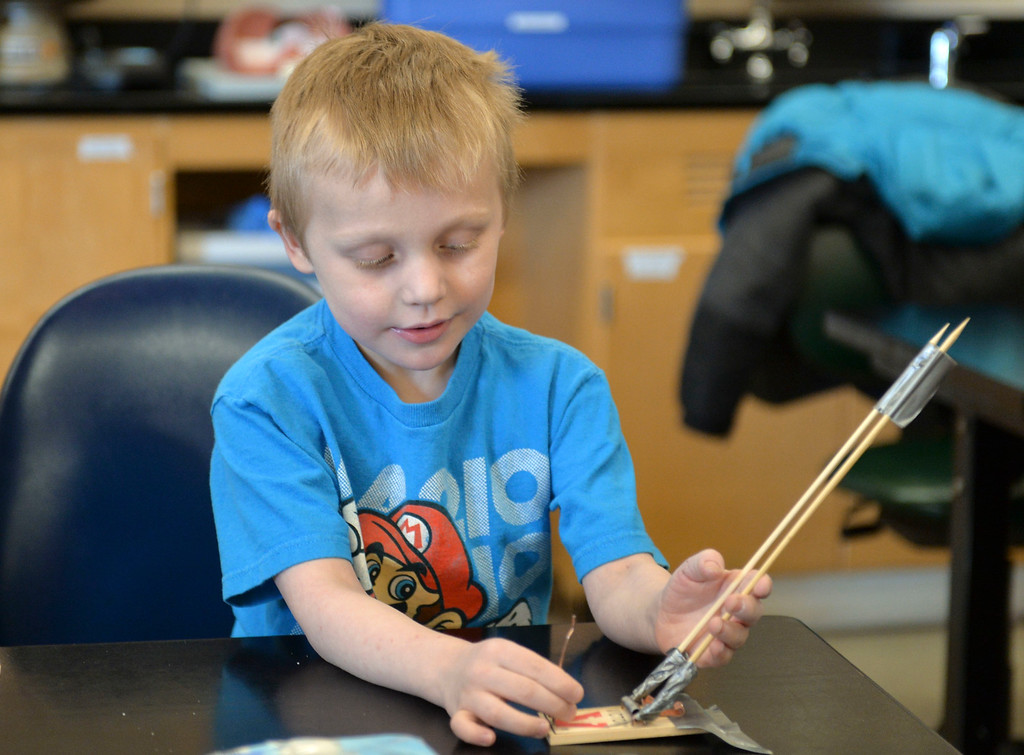 Justin Sheely | The Sheridan Press<br /> Five-year-old Gavin Rigdon sets his catapult during Science Saturday at the Sheridan College Science Center Saturday, March 24, 2018. The catapults were made from mouse traps, dowls and duct tape.