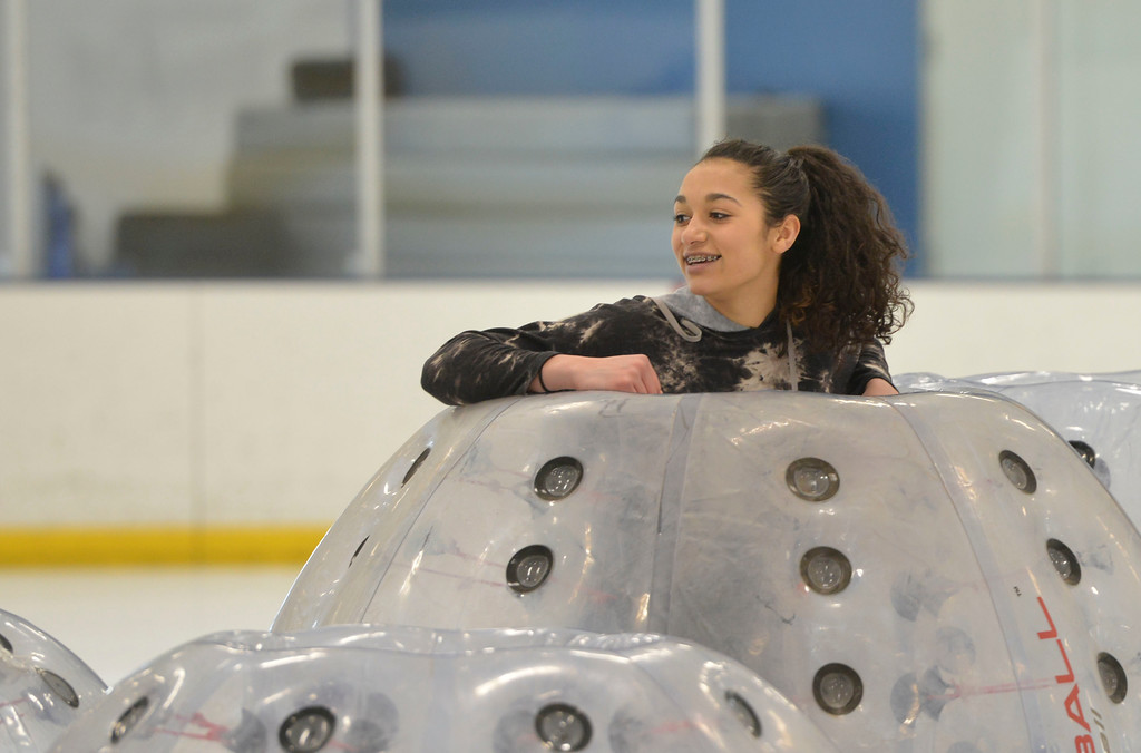 Justin Sheely | The Sheridan Press<br /> Madelynn Mendenhall waits for the games to begin during KidsLife Bubble Ball Hockey at Whitney Ice at the M&M's Center Saturday, March 24, 2018.