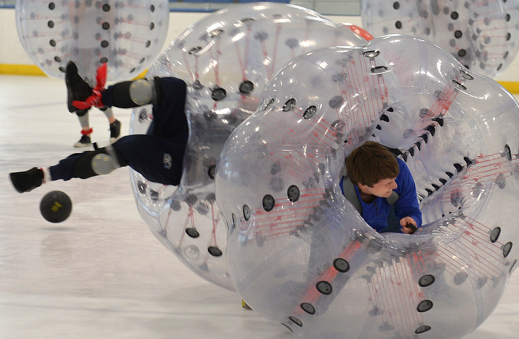 Justin Sheely | The Sheridan Press<br /> Kirby Coe-Kirkham tumbles during KidsLife Bubble Ball Hockey at Whitney Ice at the M&M's Center Saturday, March 24, 2018.