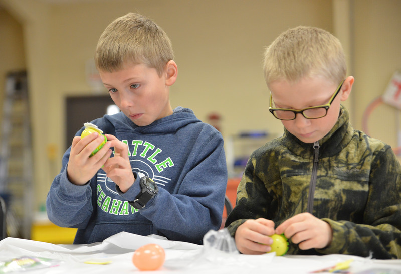 Justin Sheely | The Sheridan Press<br /> Second-grade students Payton Miles, left, and Kipton Guptill work on their easter egg craft during Fun Day Friday at the Tongue River Valley Community Center in Ranchester March 30, 2018.