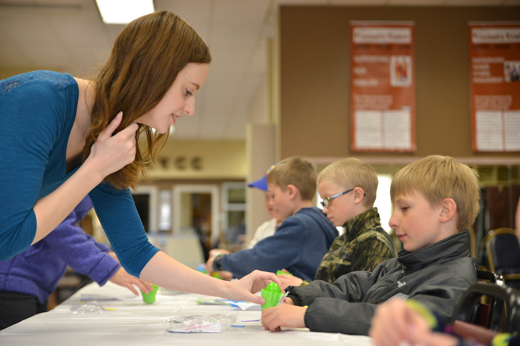 Justin Sheely | The Sheridan Press<br /> Christa Moskal, left, helps first-grader Bentley Guptill with his Easter craft during Fun Day Friday at the Tongue River Valley Community Center in Ranchester March 30, 2018.