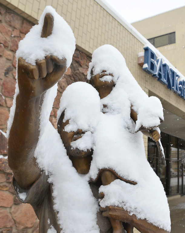 Justin Sheely | The Sheridan Press<br /> Snow collects on a sculpture on Main Street Saturday, March 31, 2018. Parts of Sherida received up to 11 inches of snow by noon Saturday, 12.5 inches was reported from Dayton.