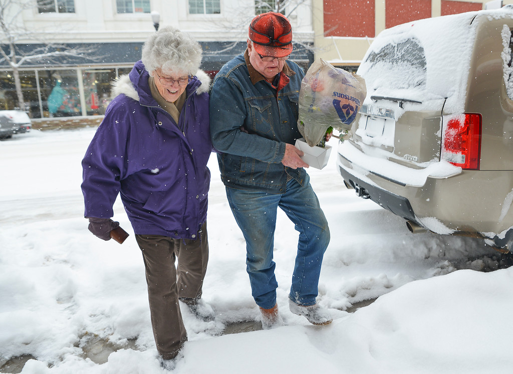 Justin Sheely | The Sheridan Press<br /> Peggy Gable, left, and John Gable walk to their car parked on Main Street in Sheridan Saturday, March 31, 2018. Parts of Sherida received up to 11 inches of snow by noon Saturday, 12.5 inches was reported from Dayton.