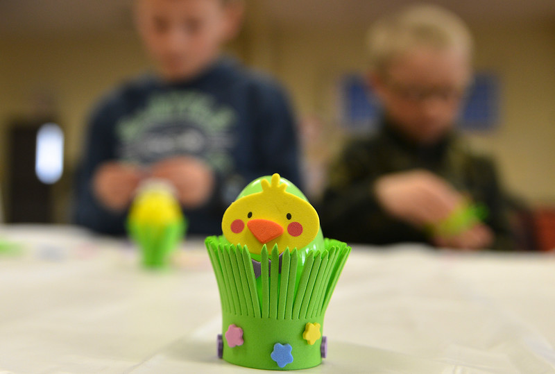 Justin Sheely | The Sheridan Press<br /> A chick peeps out of an Easter craft project during Fun Day Friday at the Tongue River Valley Community Center in Ranchester March 30, 2018.