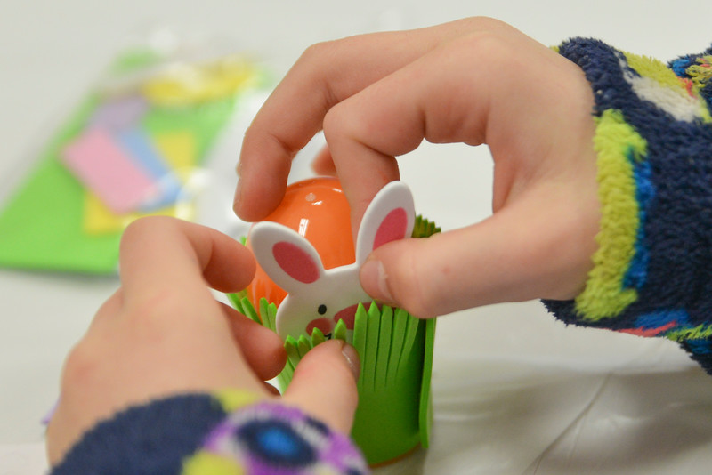 Justin Sheely | The Sheridan Press<br /> Christlyn Barron tucks in a bunny behind grass for an Easter craft during Fun Day Friday at the Tongue River Valley Community Center in Ranchester March 30, 2018.