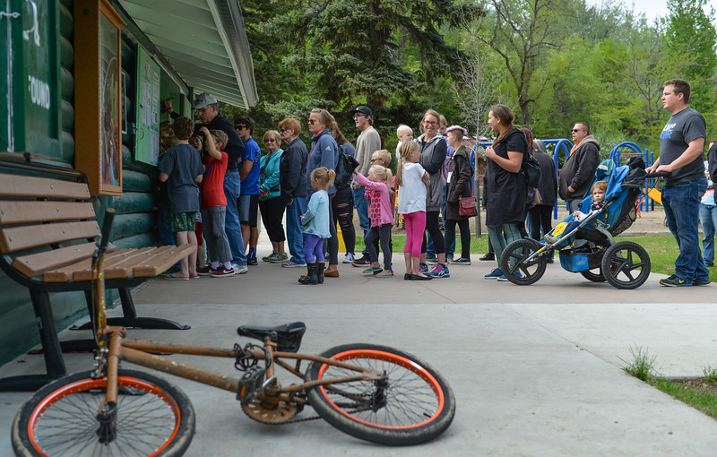 Justin Sheely | The Sheridan Press<br /> People line up on the opening day at Kendrick Ice Cream Saturday, May 19, 2018. The ice cream stand at Kendrick Park is open, May hours are weekends, 10:30 a.m. to 8 p.m. and weekdays 4 p.m. to 8 p.m.