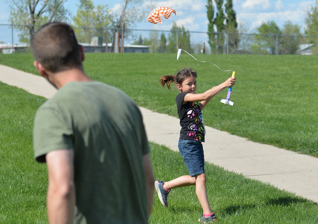 Justin Sheely | The Sheridan Press<br /> Third-grader Elizabeth Trombley catches a rocket as it parachutes down during the last day of the after school program at Sagebrush Elementary School Wednesday, May 16, 2018. Students learned about the history of rockets and how to build their own hobby model rockets during the program.