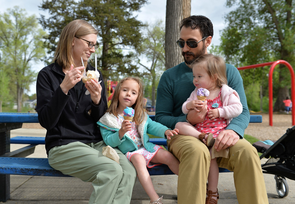 Justin Sheely | The Sheridan Press<br /> The Martinez family, from left, Kelsi, Pria, 4, AJ and Ruby, 1, enjoy scoops of ice cream on the opening day at Kendrick Ice Cream Saturday, May 19, 2018. The ice cream stand at Kendrick Park is open, May hours are weekends, 10:30 a.m. to 8 p.m. and weekdays 4 p.m. to 8 p.m.