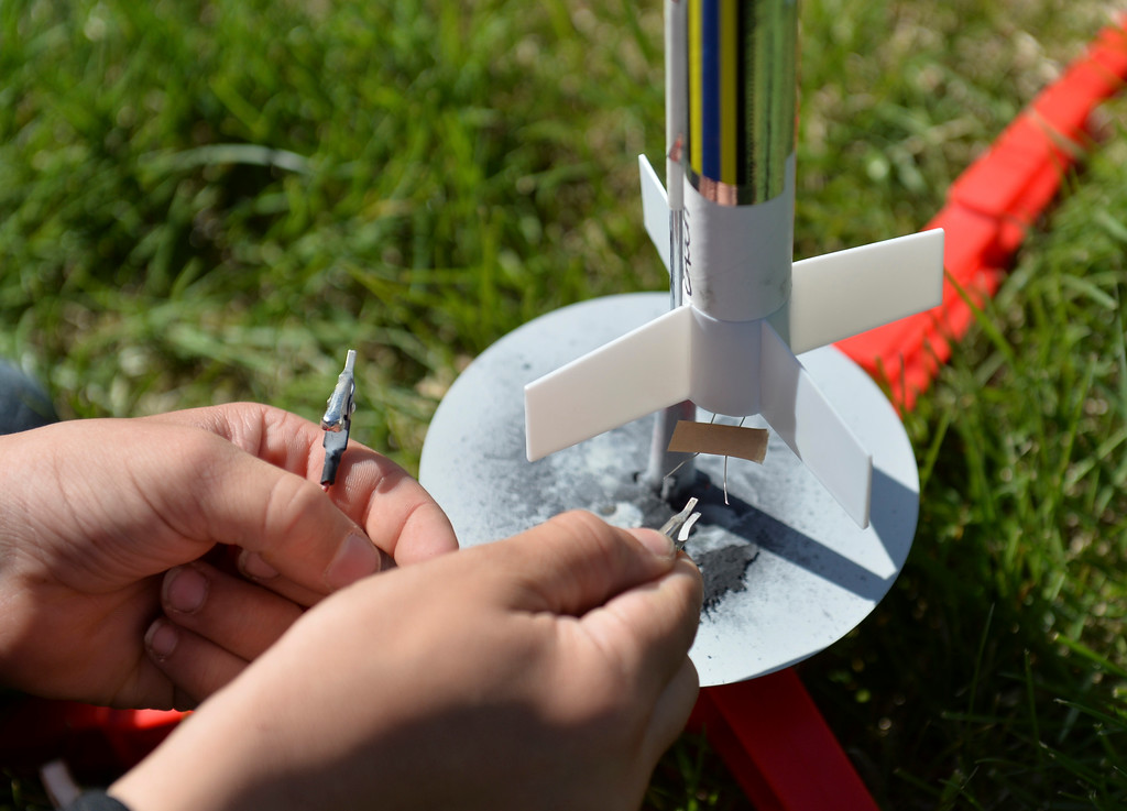 Justin Sheely | The Sheridan Press<br /> A student connects the contacts from the launcher to his model rocket during the last day of the after school program at Sagebrush Elementary School Wednesday, May 16, 2018. Students learned about the history of rockets and how to build their own hobby model rockets during the program.