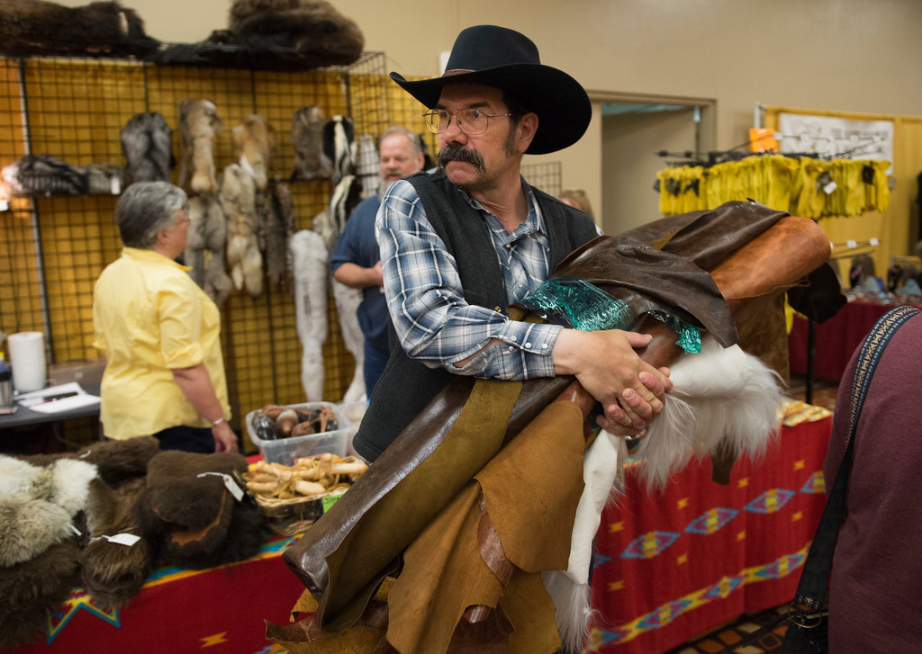 Justin Sheely | The Sheridan Press<br /> Wes Schenk of Harlowton, Montana, carries his purchase of chap leather during the Rocky Mountain Leather Trade Show at the Holiday Inn Convention Center Friday, May 18, 2018.