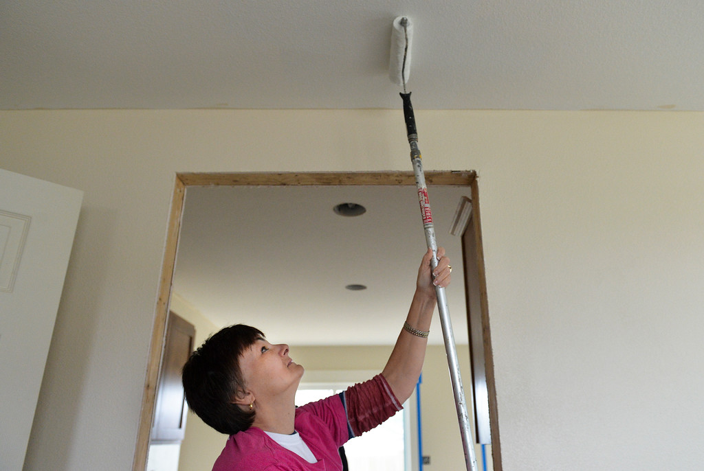 Justin Sheely | The Sheridan Press<br /> Cindy Gerhold rolls paint on the ceiling during the Thrivent Women Build day at the Habitat for Humanity homes in the Poplar Grove subdivision in Sheridan Saturday, May 19, 2018.