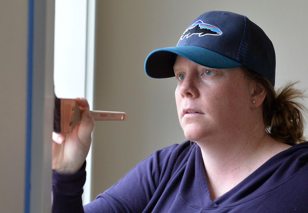 Justin Sheely | The Sheridan Press<br /> Volunteer Jenevieve Larkoski paints window trim during the Thrivent Women Build day at the Habitat for Humanity homes in the Poplar Grove subdivision in Sheridan Saturday, May 19, 2018.