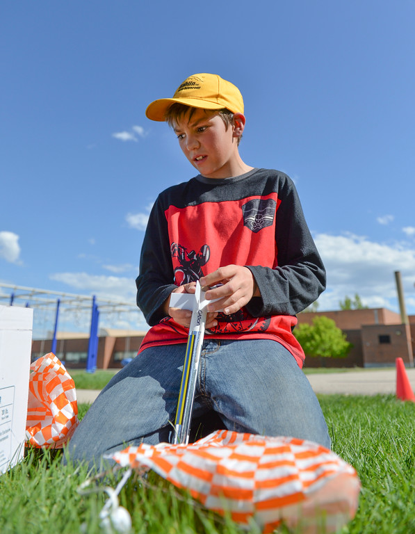 Justin Sheely | The Sheridan Press<br /> Fourth-grader Cason Kukal stuffs the parachute line into his model rocket during the last day of the after school program at Sagebrush Elementary School Wednesday, May 16, 2018. Students learned about the history of rockets and how to build their own hobby model rockets during the program.
