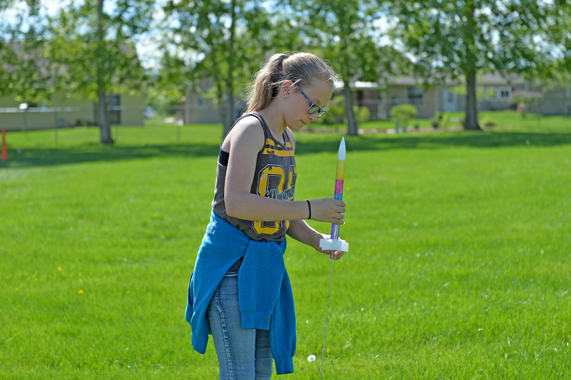 Justin Sheely | The Sheridan Press<br /> Fifth-grader Hannah Jorgensen places a model rocket on the launch pad during the last day of the after school program at Sagebrush Elementary School Wednesday, May 16, 2018. Students learned about the history of rockets and how to build their own hobby model rockets during the program.