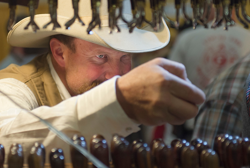 Justin Sheely | The Sheridan Press<br /> Ron Ostrom of Powell, Wyoming, takes a look at Barry King leather tools during the Rocky Mountain Leather Trade Show at the Holiday Inn Convention Center Friday, May 18, 2018.