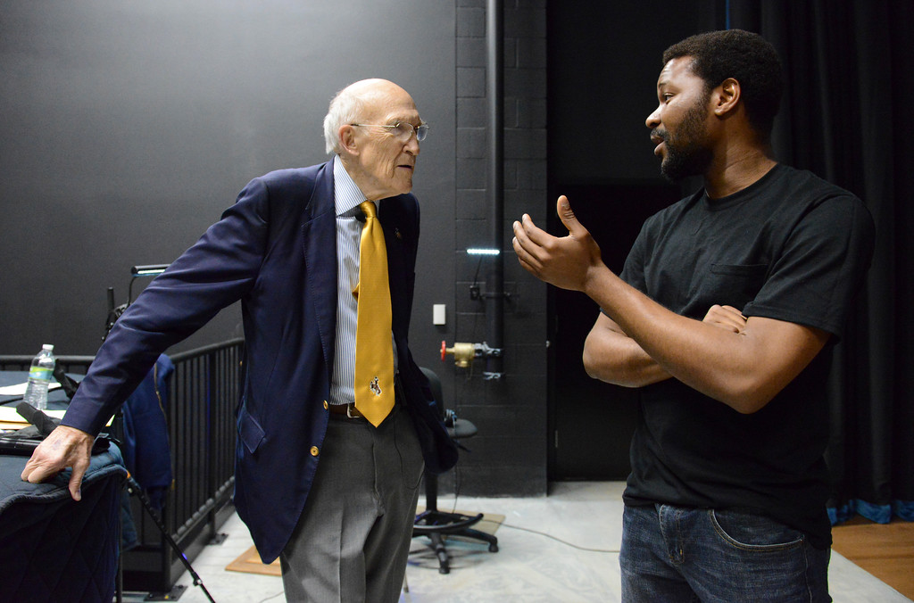 Justin Sheely | The Sheridan Press<br /> Alan Simpson, left, visits with Sheridan College music student Ebenezer Eferobot of Nigeria prior to the lecture at the Whitney Center for the Arts Thursday, May 17, 2017.