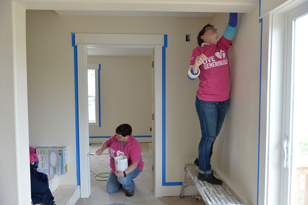 Justin Sheely | The Sheridan Press<br /> Volunteers Rose Burns, left, and Gail Symons paint and tape during the Thrivent Women Build day at the Habitat for Humanity homes in the Poplar Grove subdivision in Sheridan Saturday, May 19, 2018.