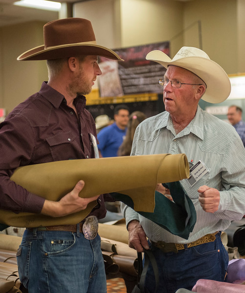 Justin Sheely | The Sheridan Press<br /> Shiloh Holthus, left, and Charlie Holthus look over chap hides during the Rocky Mountain Leather Trade Show at the Holiday Inn Convention Center Friday, May 18, 2018.