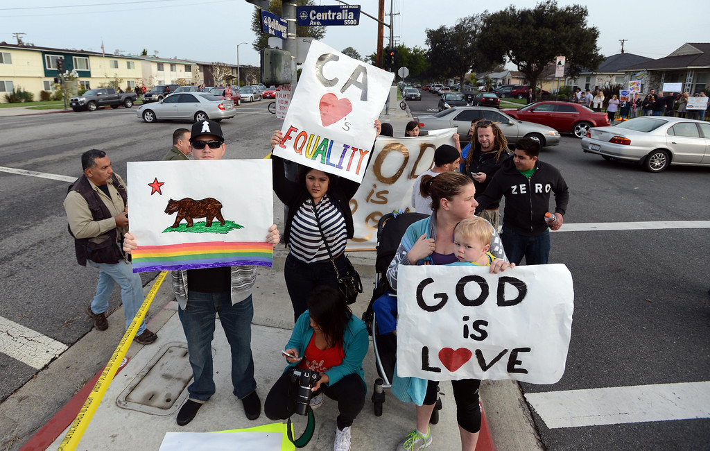 . Westboro Baptist Church counter protesters at the corner of Centralia Ave. and Bellflower Blvd. in Lakewood, where Westboro Baptist Church members staged a protest Monday morning.  Lakewood Calif., Monday,  March 3,  2014.   (Photo by Stephen Carr / Daily Breeze)