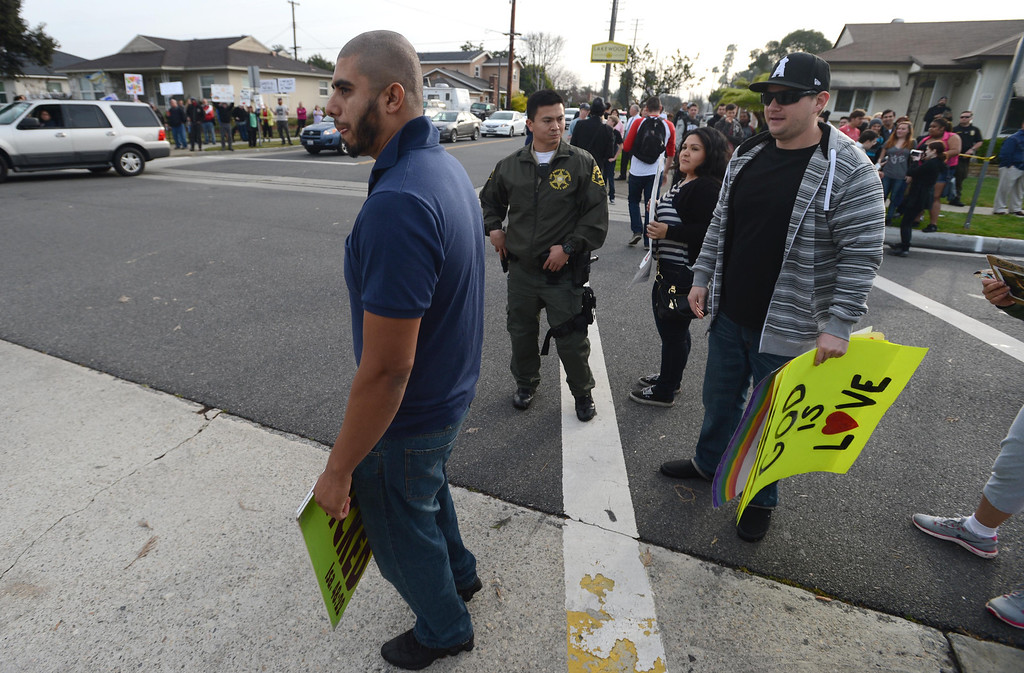 . Westboro Baptist Church counter-protesters confront a church member at the corner of Centralia Ave. and Bellflower Blvd. in Lakewood, where Westboro Baptist Church members staged a protest Monday morning.  Lakewood Calif., Monday,  March 3,  2014.   (Photo by Stephen Carr / Daily Breeze)