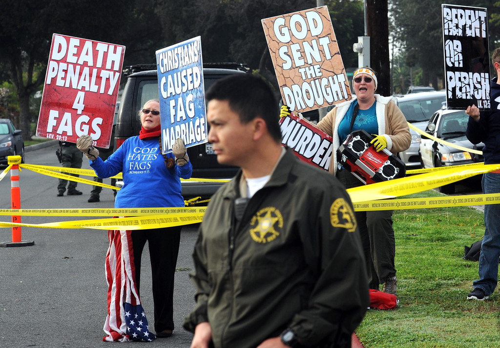 . Westboro Baptist Church members staged a protest Monday morning, at the corner of Centralia Ave. and Bellflower Blvd. in Lakewood. Lakewood Calif., Monday,  March 3,  2014.   (Photo by Stephen Carr / Daily Breeze)