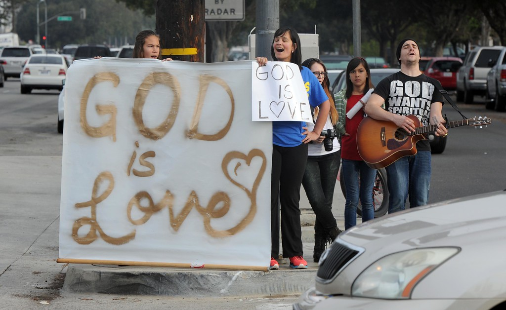 . Westboro Baptist Church counter-protesters at the corner of Centralia Ave. and Bellflower Blvd. in Lakewood, where Westboro Baptist Church members staged a protest Monday morning.  Lakewood Calif., Monday,  March 3,  2014.   (Photo by Stephen Carr / Daily Breeze)