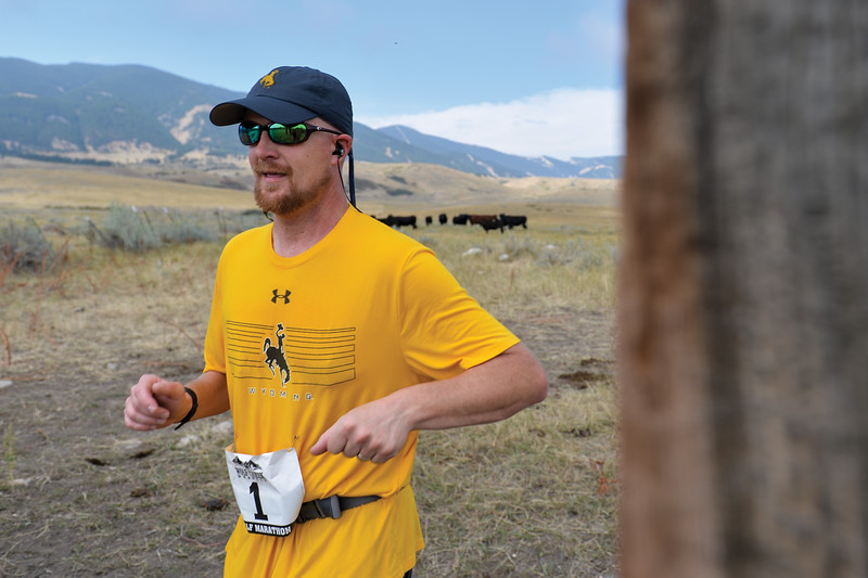 Ashleigh Fox | The Sheridan Press<br> Craig Achord of Sheridan runs through the gate at the last aid station during the Wolf Creek Wrangle Saturday, Sept. 15, 2018. Achord earned a 10th place finish overall in the half marathon.