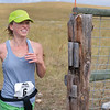 Ashleigh Fox | The Sheridan Press<br> Haley Hendrickson of Sheridan runs through the gate at the last aid station during the Wolf Creek Wrangle Saturday, Sept. 15, 2018. Hendrickson earned a sixth place finish overall in the half marathon.
