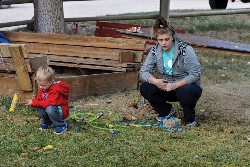 Ashleigh Fox | The Sheridan Press<br> Sage Schultz watches her son, Teigen, play while at the Wolf Creek Wrangle. Schultz and her two sons will be recipients of a Habitat for Humanity home.