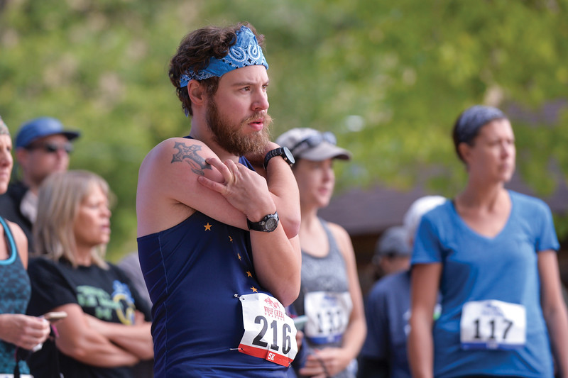 Ashleigh Fox | The Sheridan Press<br> John Mumm of Banner stretches ahead of the Wolf Creek Wrangle 5K Saturday, Sept. 15, 2018. AMumm came in first for the race.