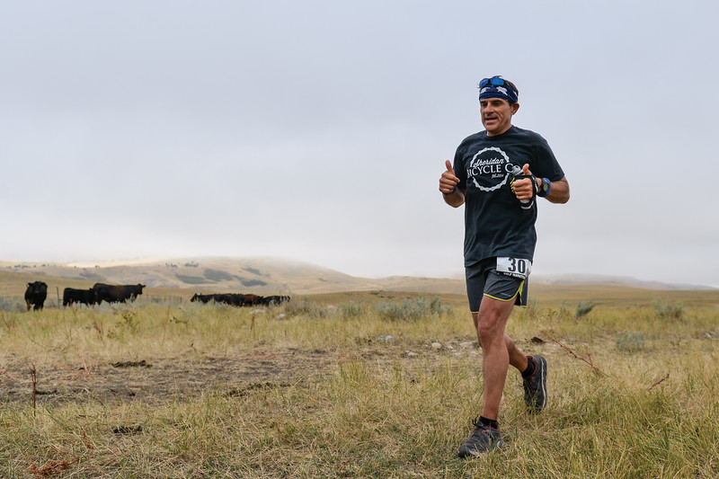 Ashleigh Fox | The Sheridan Press<br> Jeff Volmer of Dayton gives a thumbs up during the Wolf Creek Wrangle Saturday, Sept. 15, 2018. Volmer earned third place overall in the half marathon.