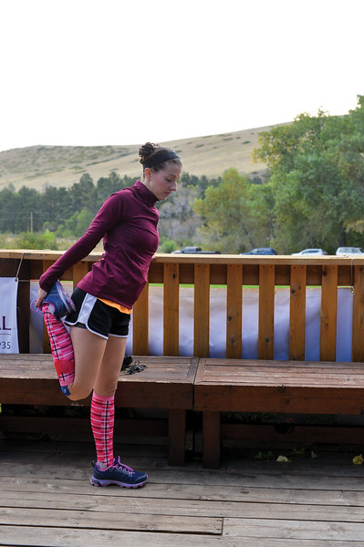 Ashleigh Fox | The Sheridan Press<br> Chelsea Bestram of Sheridan stretches ahead of the Wolf Creek Wrangle 5K Saturday, Sept. 15, 2018. Bestram finished 10th in the race.