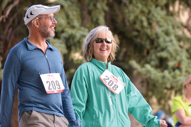 Ashleigh Fox | The Sheridan Press<br> Gini Horner, right, walks hand-in-hand with her husband, Mike Horner, to start the Wolf Creek Wrangle 5K Saturday, Sept. 15, 2018. Participants had the option to run or hike the course.