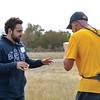 Ashleigh Fox | The Sheridan Press<br /> Jackson Craig hands a sports drink to Craig Achord of Sheridan at the last aid station during the Wolf Creek Wrangle Saturday, Sept. 15, 2018. Achord earned a 10th place finish overall in the half marathon.