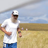 Ashleigh Fox | The Sheridan Press<br> Jim Zier of Sheridan runs through the gate at the last aid station during the Wolf Creek Wrangle Saturday, Sept. 15, 2018. Zier finished 11th overall in the half marathon.