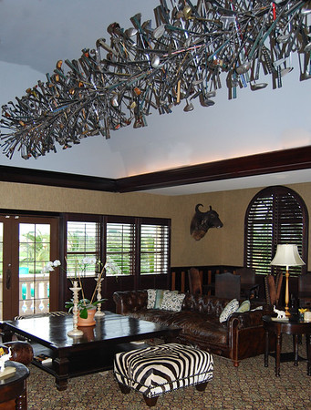 """Sculpture By Maison made of Golf clubs hangs over """"The Duke's Bar and Lounge"""""""