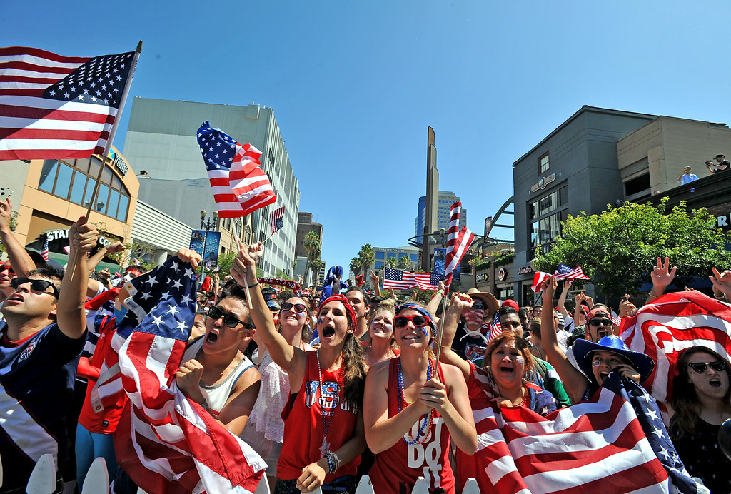 . Fans packed Pine Avenue to watch the United States play Belgium in the World Cup Soccer game react to the USA goal late in the game in Long Beach CA. on Tuesday July 01, 2014. (Photo by Sean Hiller/ Daily Breeze).