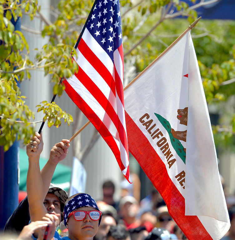 . Jose Gomez of Bell Gardens watch the jumbo screen on Pine Avenue to watch the United States play Belgium in the World Cup Soccer game in Long Beach CA. on Tuesday July 01, 2014. (Photo by Sean Hiller/ Daily Breeze). .