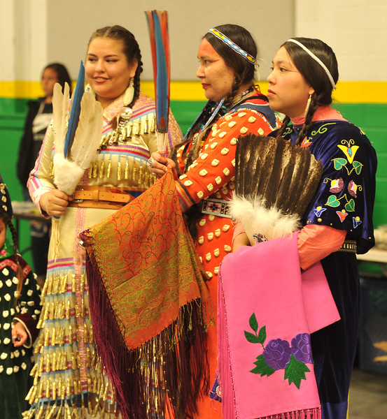 Ryan Patterson | The Sheridan Press<br /> From left: Korra Poitra, Precious Beardontwalk and Awna Bad Bear participate in Native American Week at the Wyola Public School Friday, Sept. 28, 2018. The day involved a parade, powwow and meal to celebrate Native American tradition and culture.