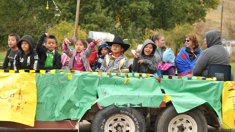 Ryan Patterson | The Sheridan Press<br /> Students throw candy in a parade during Native American Week at the Wyola Public School Friday, Sept. 28, 2018. The day involved a parade, powwow and meal to celebrate Native American tradition and culture.