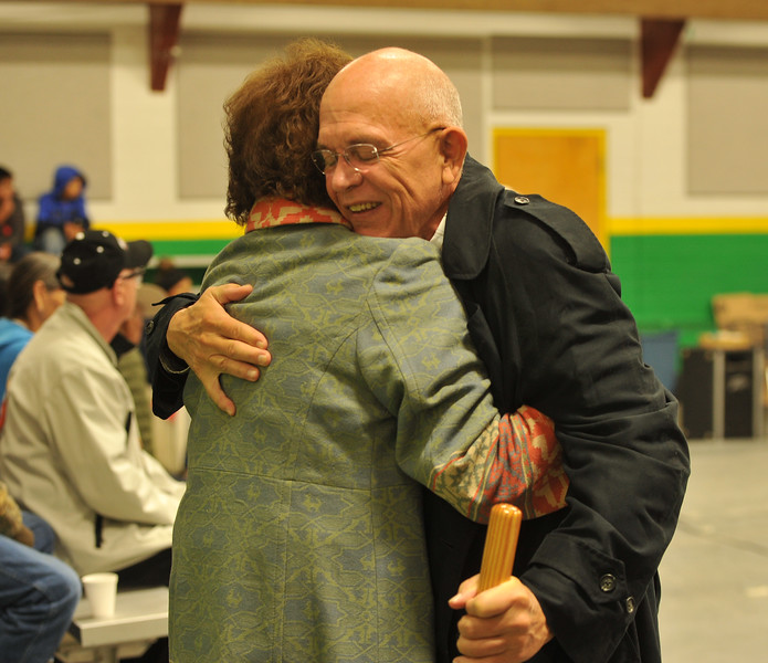 Ryan Patterson | The Sheridan Press<br /> Harvey Stewart, right, hugs Joan WhiteManRunsHim during Native American Week at the Wyola Public School Friday, Sept. 28, 2018. The day involved a parade, powwow and meal to celebrate Native American tradition and culture.