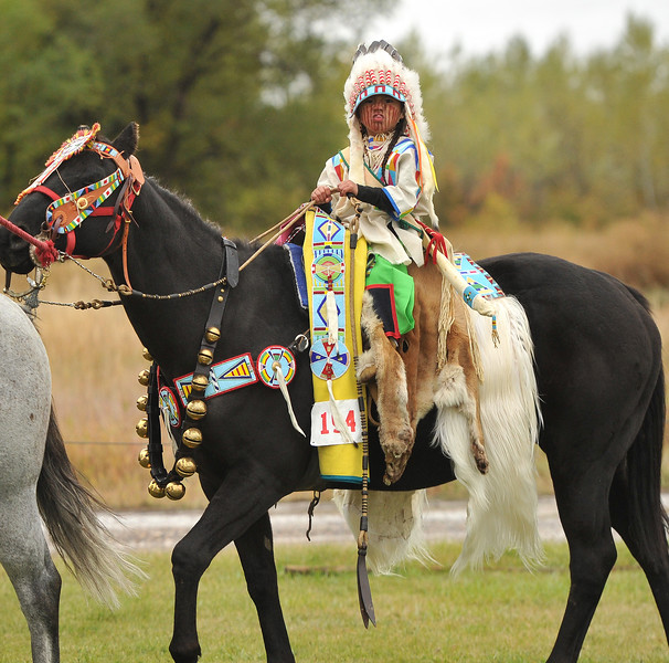 Ryan Patterson | The Sheridan Press<br /> Student Jericho Bullweasel rides a horse during Native American Week at the Wyola Public School Friday, Sept. 28, 2018. The day involved a parade, powwow and meal to celebrate Native American tradition and culture.