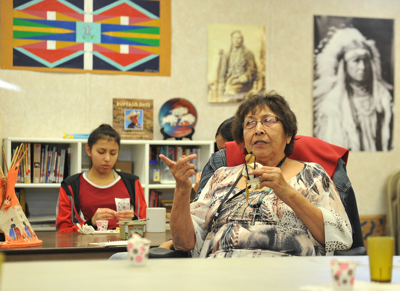 Ryan Patterson | The Sheridan Press<br /> Wyola School Crow studies instructor Janice Wilson tells a story to Sheridan Junior High School students during a cultural event at the Art Culture and Elder's Center in Wyola, Montana, Tuesday, Nov. 20, 2018. About 15 students from each school spent more than two hours doing several different activities.