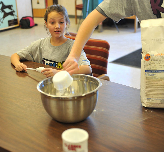 Ryan Patterson | The Sheridan Press<br /> Sheridan Junior High School sixth-grader Mackenzie Thorson observes part of the bread-making process during a cultural event at the Art Culture and Elder's Center in Wyola, Montana, Tuesday, Nov. 20, 2018. About 15 students from each school spent more than two hours doing several different activities.
